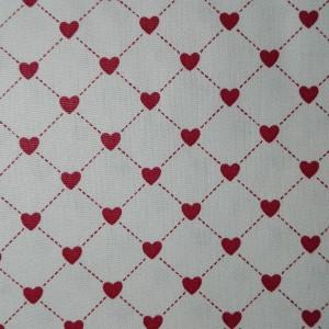 Tessuto in Cotone Panna con Cuori Rossi